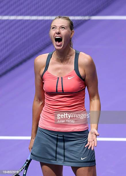 Maria Sharapova of Russia celebrates defeating Victoria Azarenka of Belarus in the semi finals during day five of the season ending TEB BNP Paribas...