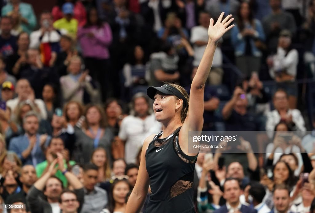 Maria Sharapova of Russia celebrates her victory over Simona Halep of Romania during their Women's Singles match at the 2017 US Open Tennis Tournament August 28, 2017 in New York. Sharapova marked her first Grand Slam appearance since her doping ban ended with a 6-4, 4-6, 6-3 victory over second seed Halep. /