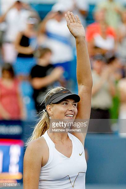 Maria Sharapova of Russia celebrates her win over Jelena Jankovic of Serbia during the final of the Western & Southern Open at the Lindner Family...