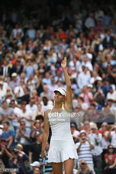 Maria Sharapova of Russia celebrates match point after her ladies' singles first round match against Anastasia Rodionova of Australia on day one of...