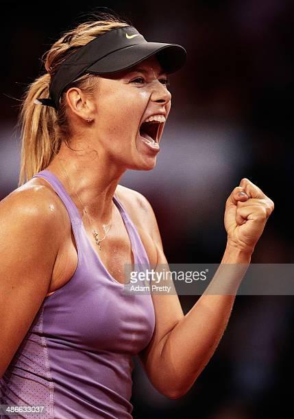 Maria Sharapova of Russia celebrates match point after her match against Agnieszka Radwanska of Poland on day five of the Porsche Tennis Grand Prix...