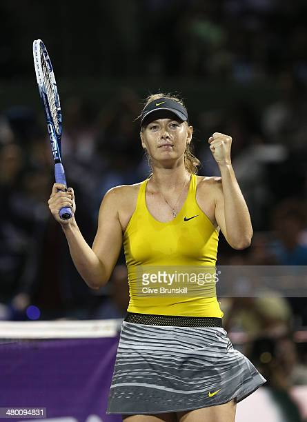 Maria Sharapova of Russia celebrates match point after her three set victory against Lucie Safarova of the Czech Republic during their second round...