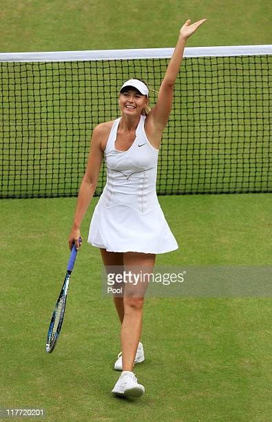 Maria Sharapova of Russia celebrates match point after winning her semifinal round match against Sabine Lisicki of Germany on Day Ten of the...