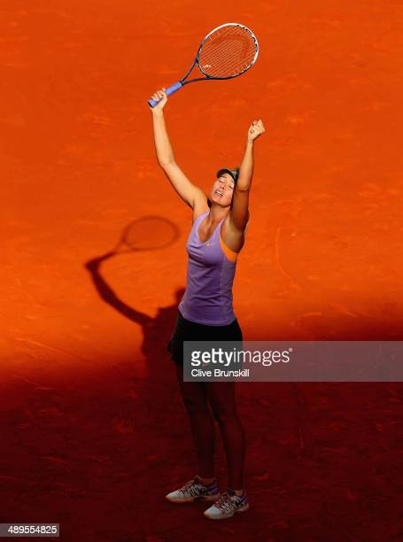 Maria Sharapova of Russia celebrates match point against Simona Halep of Romania in their final match during day nine of the Mutua Madrid Open tennis...