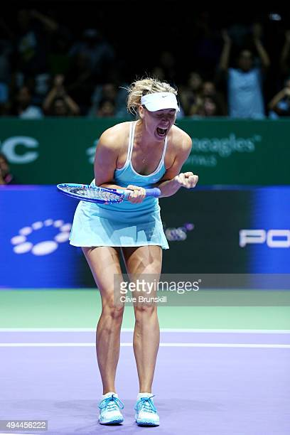 Maria Sharapova of Russia celebrates match point against Simona Halep of Romania in a round robin match during the BNP Paribas WTA Finals at...