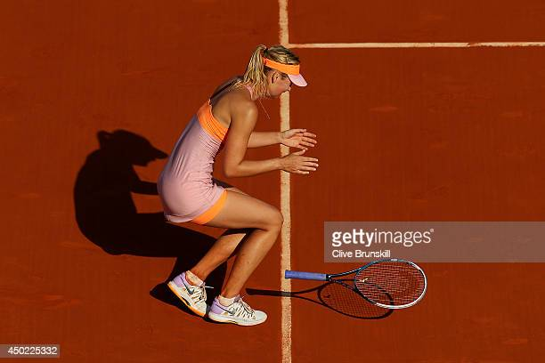Maria Sharapova of Russia celebrates match point during her women's singles final match against Simona Halep of Romania on day fourteen of the French...