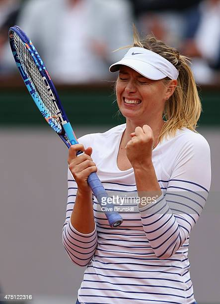 Maria Sharapova of Russia celebrates match point in her Women's Singles match against Samantha Stosur of Australia on day six of the 2015 French Open...