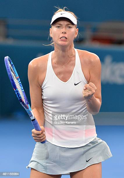 Maria Sharapova of Russia celebrates victory after defeating Carla Suarez Navarro of Spain during day five of the 2015 Brisbane International at Pat...