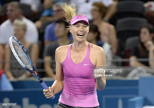 Maria Sharapova of Russia celebrates victory after winner her match against Caroline Garcia of France during day two of the 2014 Brisbane...