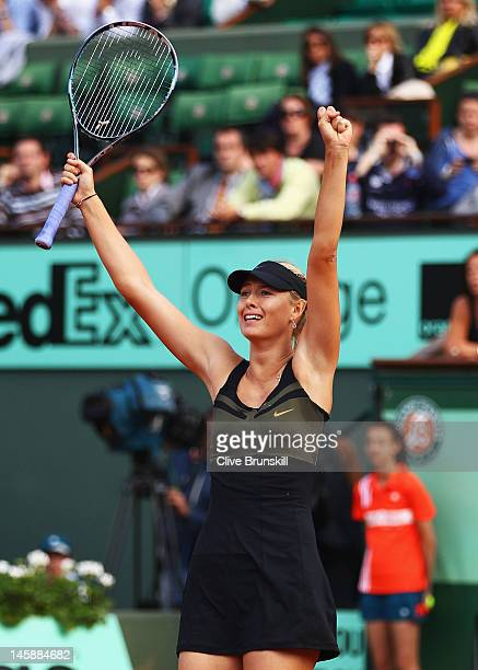Maria Sharapova of Russia celebrates victory and becoming WTA world number one after her women's semi final match against Petra Kvitova of Czech...