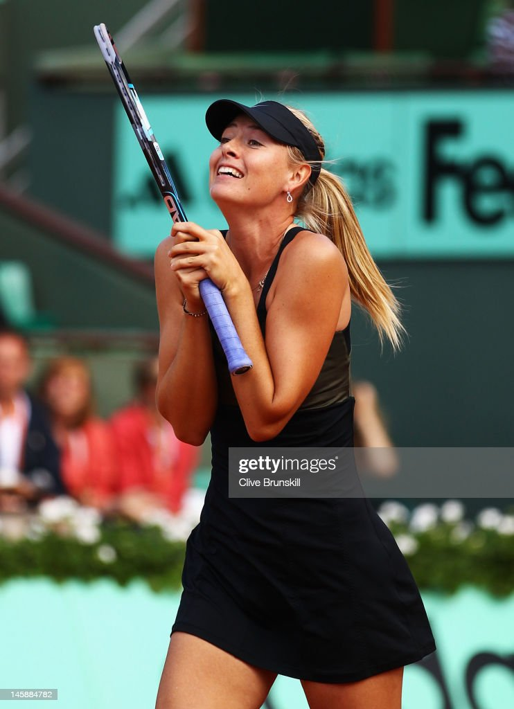 Maria Sharapova of Russia celebrates victory and becoming WTA world number one after her women's semi final match against Petra Kvitova of Czech Republic during day 12 of the French Open at Roland Garros on June 7, 2012 in Paris, France.