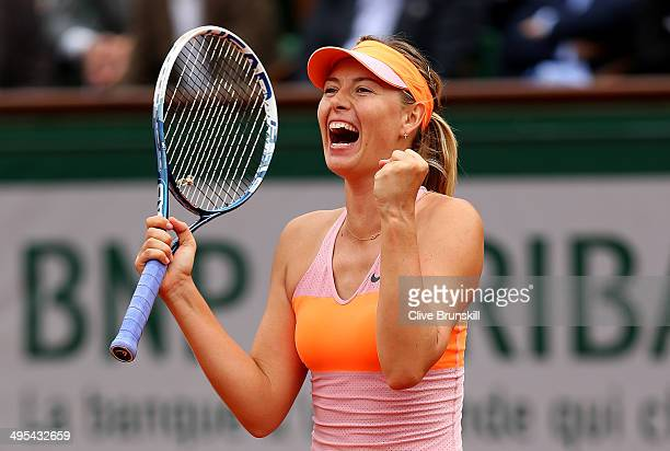 Maria Sharapova of Russia celebrates victory during her women's singles match against Garbine Muguruza of Spain on day ten of the French Open at...