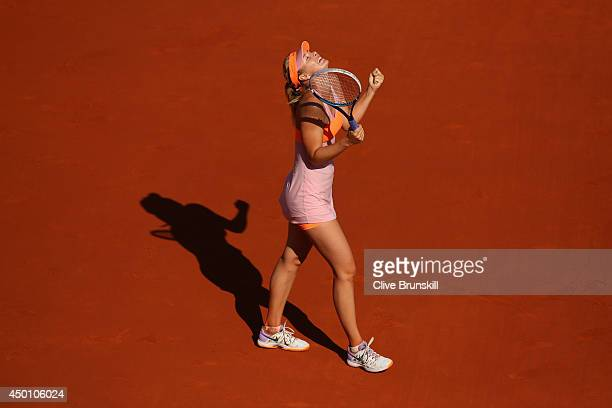 Maria Sharapova of Russia celebrates victory during her women's singles semi-final match against Eugenie Bouchard of Canada on day twelve of the...