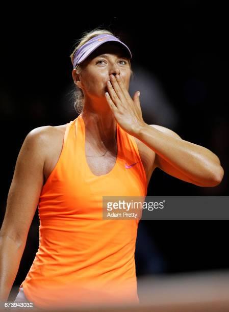Maria Sharapova of Russia celebrates victory in her match against Erkaterina Makarova of Russia during the Porsche Tennis Grand Prix at Porsche Arena...
