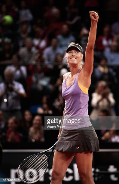 Maria Sharapova of Russia celebrates victory in the final against Ana Ivanovic of Serbia on day seven of the Porsche Tennis Grand Prix 2014 at...
