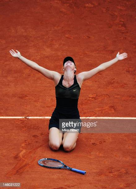 Maria Sharapova of Russia celebrates victory in the women's singles final against Sara Errani of Italy during day 14 of the French Open at Roland...
