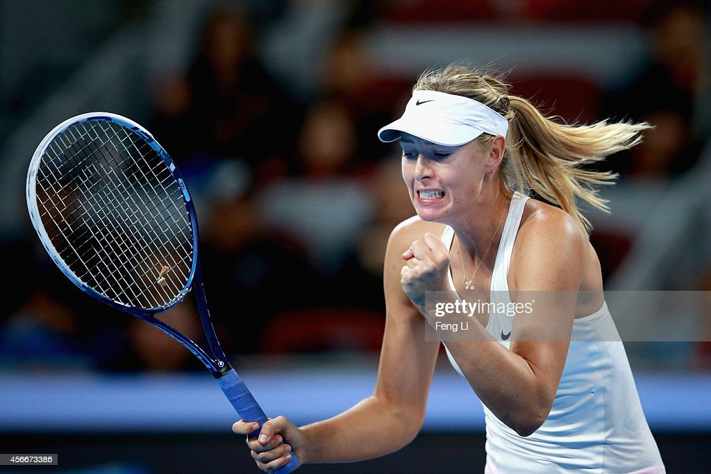Maria Sharapova of Russia celebrates winning a ball during the Women's Single Final against Petra Kvitova of Czech Republic on day nine of the China Open at the China National Tennis Center on October 5, 2014 in Beijing, China.