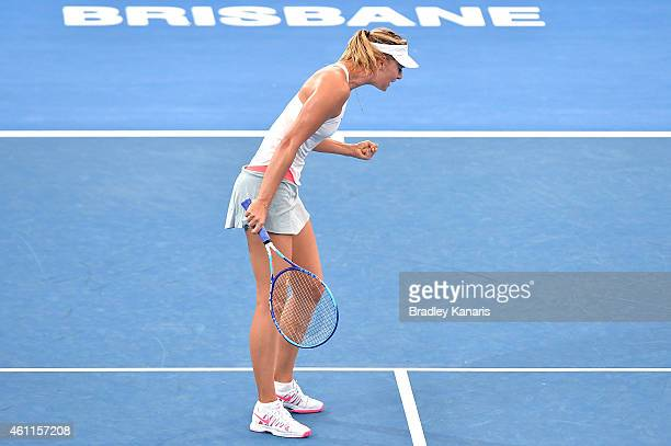 Maria Sharapova of Russia celebrates winning a break point in her match against Carla Suarez Navarro of Spain during day five of the 2015 Brisbane...