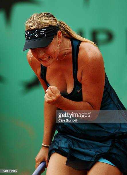 Maria Sharapova of Russia celebrates winning a point against Anna Chakvetadze of Russia during the Women's Singles Quarter Final match on day ten of...