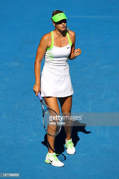 Maria Sharapova of Russia celebrates winning a point in her semifinal match against Petra Kvitova of the Czech Republic during day eleven of the 2012...
