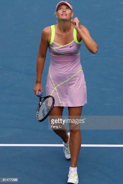 Maria Sharapova of Russia celebrates winning against Victoria Azarenka of Belarus in her first round match during day five of the 2009 China Open at...