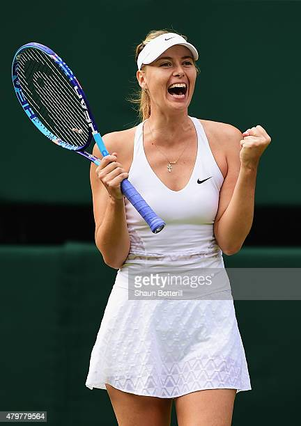 Maria Sharapova of Russia celebrates winning her Ladies Singles Quarter Final match against Coco Vandeweghe of the United States during day eight of...