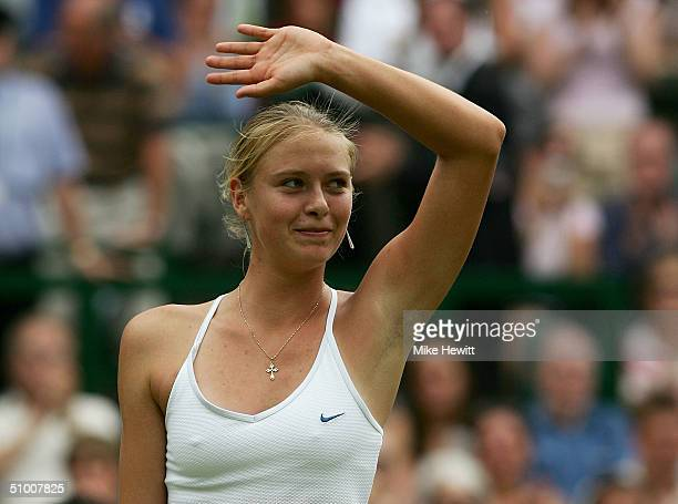 Maria Sharapova of Russia celebrates winning her quarter final match against Ai Sugiyama of Japan at the Wimbledon Lawn Tennis Championship on June...