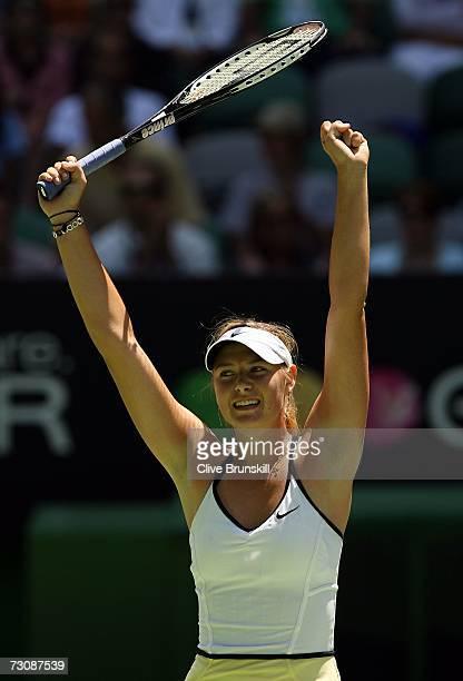 Maria Sharapova of Russia celebrates winning her quarterfinal match against Anna Chakvetadze of Russia on day ten of the Australian Open 2007 at...