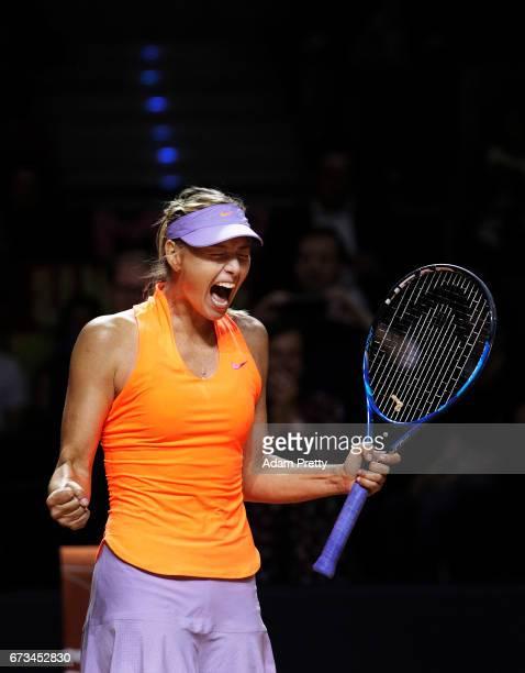 Maria Sharapova of Russia celebrates winning match point against Roberta Vinci of Italy during the Porsche Tennis Grand Prix at Porsche Arena on...