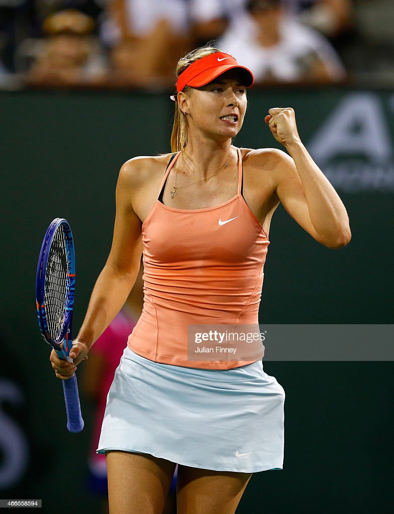 Maria Sharapova of Russia celebrates winning the first set against Victoria Azarenka of Belarus during day eight of the BNP Paribas Open tennis at the Indian Wells Tennis Garden on March 16, 2015 in Indian Wells, California.