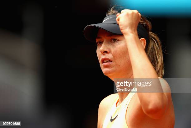 Maria Sharapova of Russia celebrates winning the first set against IrinaCamelia Begu of Romania in their second round match during day three of the...