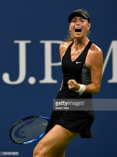 Maria Sharapova of Russia celebrates winning the first set during her women's singles first round match against Patty Schnyder of Switzerland on Day...