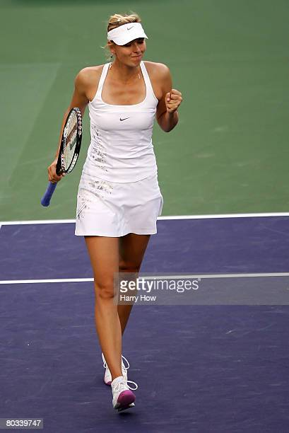 Maria Sharapova of Russia celebrates winning the second set while playing Svetlana Kuznetsova of Russia during the Pacific Life Open at the Indian...