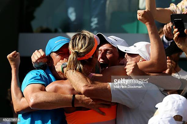 Maria Sharapova of Russia celebrates with her team following her victory in her women's singles final match against Simona Halep of Romania on day...