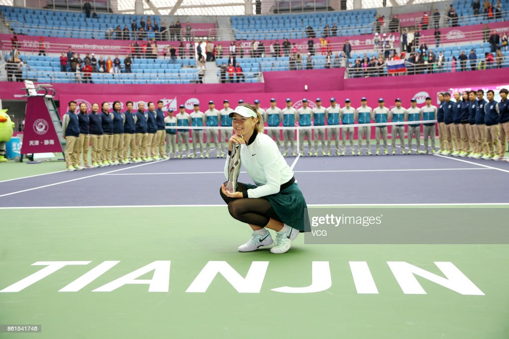 Maria Sharapova of Russia celebrates with her trophy after winning the women's singles final match against Aryna Sabalenka of Belarus at the WTA Tianjin Open tennis tournament on October 15, 2017 in Tianjin, China.