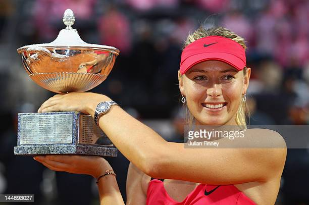 Maria Sharapova of Russia celebrates with the trophy after defeating Na Li of China during their final match during day nine of the Internazionali...