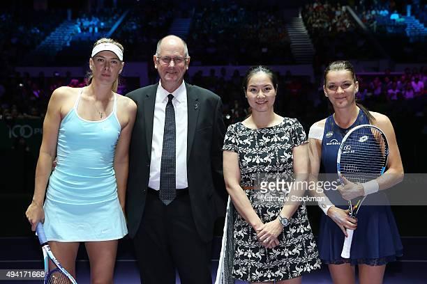 Maria Sharapova of Russia, CEO of the WTA Steve Simon, WTA Finals ambassador Li Na and Agnieszka Radwanska of Poland pose for a photo after the coin...