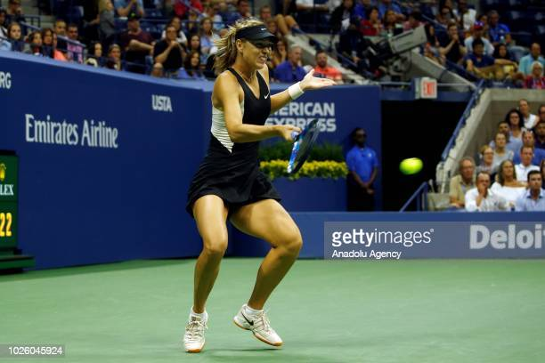 Maria Sharapova of Russia competes against Jeena Ostapenko of Latvia during US Open 2018 tournament in Arthur Ashe Stadium in Flushing New York...