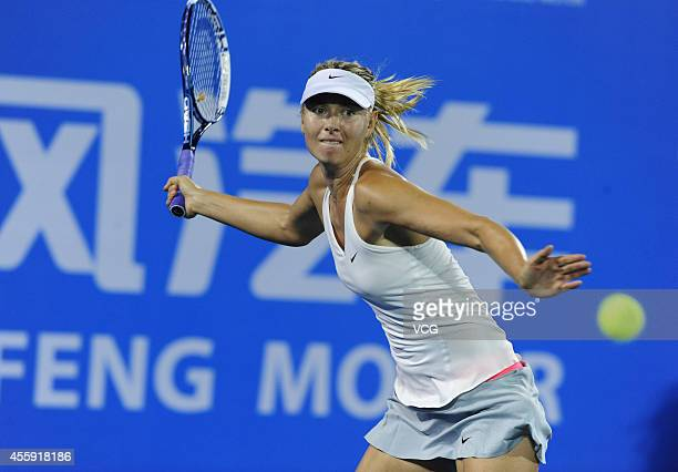 Maria SHARAPOVA of Russia competes with Svetlana KUZNETSOVA of Russia during day two of the 2014 Dongfeng Motor Wuhan Open at Optics Valley...
