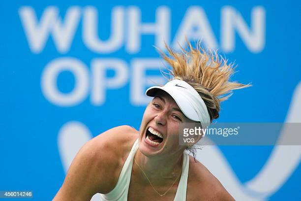Maria SHARAPOVA of Russia competes with Timea BACSINSZKY of Switzerland during day four of the 2014 Dongfeng Motor Wuhan Open at Optics Valley...