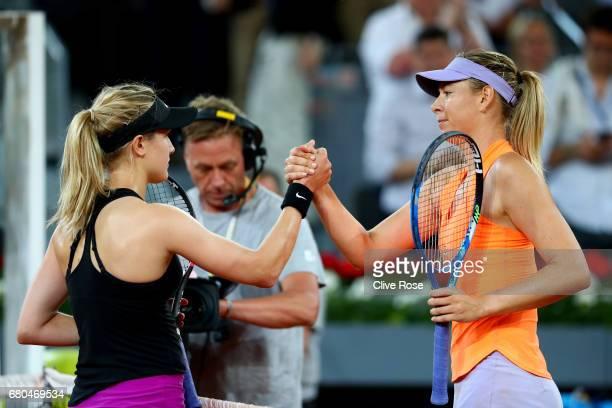 Maria Sharapova of Russia congratulates Eugenie Bouchard of Canada at the end of the match on day three of the Mutua Madrid Open tennis at La Caja...