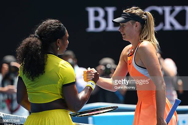 Maria Sharapova of Russia congratulates Serena Williams of the United States on winning their quarter final match during day nine of the 2016...