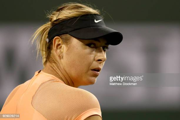 Maria Sharapova of Russia cools down between games while playing Naomi Osaka of Japan during the BNP Paribas Open at the Indian Wells Tennis Garden...