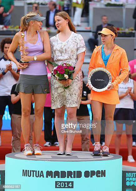 Maria Sharapova of Russia Dinara Safina of Russia and Simona Halep of Romania hold there winner and runner up trophies after their final match during...