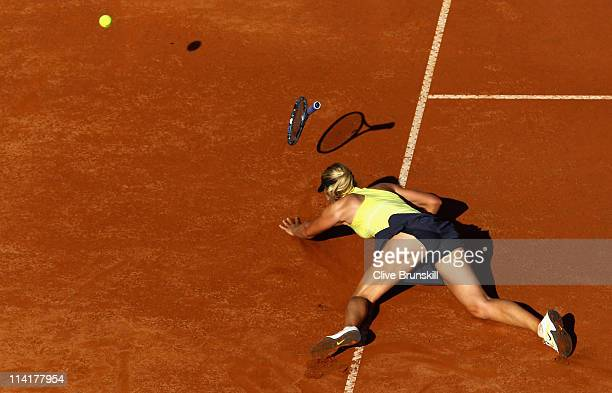 Maria Sharapova of Russia falls during her semi final match against Caroline Wozniacki of Denmark during day seven of the Internazoinali BNL D'Italia...