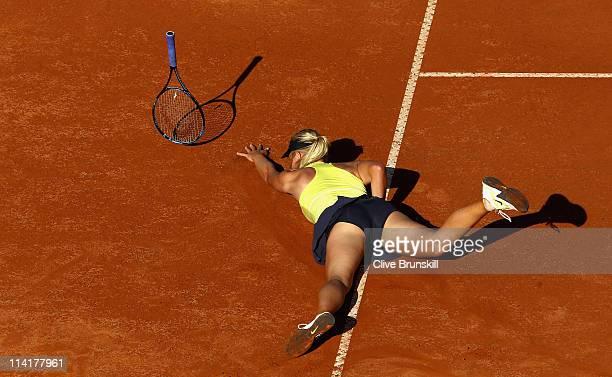 Maria Sharapova of Russia falls during her semi final match against Caroline Wozniacki of Denmark during day seven of the Internazoinali BNL D'Italia...