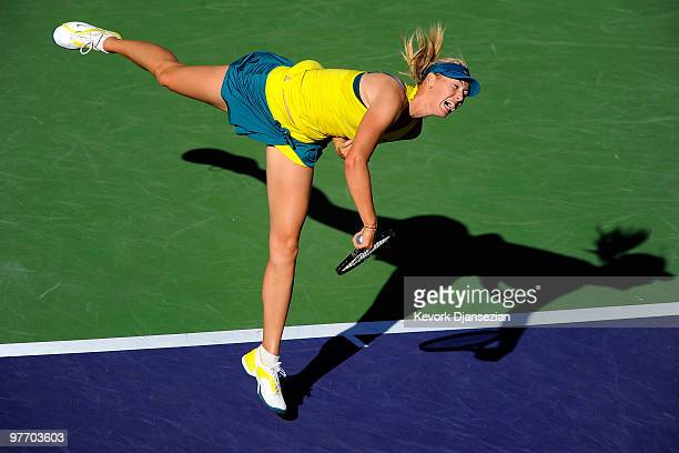 Maria Sharapova of Russia follows through on a serve against Jie Zheng of China during the BNP Paribas Open on March 14 2010 in Indian Wells...