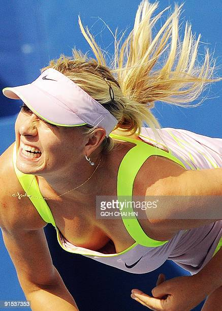 Maria Sharapova of Russia follows through on a serve against Victoria Azarenka of Belarus during their second round match at the China Open 2009 in...