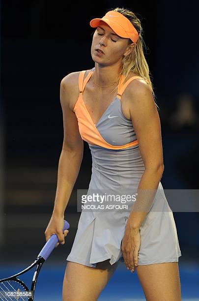 Maria Sharapova of Russia gestures during her fourth round women's singles match against Andrea Petkovic of Germany on the seventh day of the...