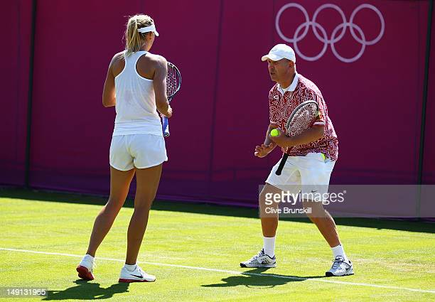 Maria Sharapova of Russia gets instrucions by her coach Thomas Hogstedt in a practice session during previews ahead of the 2012 London Olympic Games...